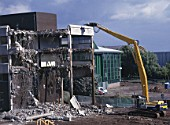 Demolition of reinforced concrete frame buildings in Cwmbran for redevelopment of town centre using Komatsu plant.
