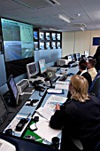 Controllers at the surveillance desk monitoring the M6 toll, UK.