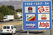 Economy USA, FAST FOOD: sign at the Interstate gives information about restaurants coming at the next exit