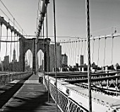 Brooklyn Bridge with New York skyline. The Brooklyn Bridge opened in May 24,1883. Twenty seven construction workers died during its construction. Engineer: John Augustus Roabling and Wilhelm Hildenbrand. 150,000 vehicles use the bridge every day.
