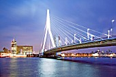 802 meters Erasmus bridge over Maas - Meuse river at Wilhelminapier, Rotterdam, Netherlands. The Cable-stayed bridge with inclined pylon and semi-fan arrangement was opened in 1996.
