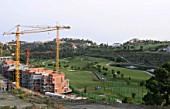 Los Arqueros Golf Course with new construction within the hills of the Costa del Sol, near Marbella, Spain.