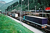 Austria, Brenner Pass, border to Italy: Trucks are loaded on railroad cargo. The Brenner Pass is the most important throughway over the central Alps and connects the Austrian region of Tyrol with the Italian region of Southern Tyrol.