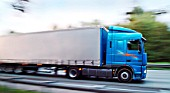 Trucks in motion on German motorway.