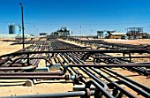Pipelines at Oil field in southern Oman, Middle East.