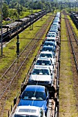 Car transporter train carrying BMW cars, Munich, Bavaria, Germany