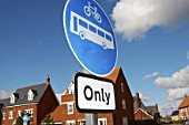 Road sign displaying bus and cycle access only on a new housing development