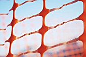 Close-up of orange plastic fencing on a construction site
