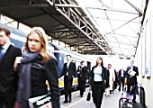 Commuters departing a busy London train station