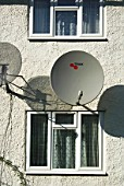 Satellite dishes fastened on the exterior of a domestic property