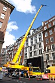 Mobile crane blocking off a street, London