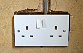 A new plug socket chased into a wall