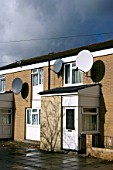 Satellite dishes on council housing estate, England, UK