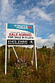 Sale agreed sign for land lots, UK