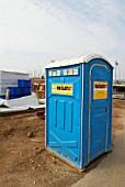 Portable toilet on construction site