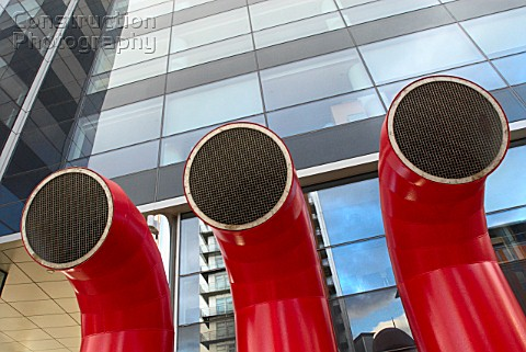 Red vent ducts outside office building