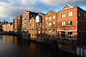 Apartments in converted warehouses on the River Aire, Leeds, Yorkshire, UK