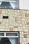Artificial stone facade on a wall of a house, Ipswich, UK