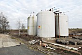 Storage tanks at a disused factory, Manningtree, Suffolk, UK