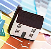Model cottage on paint swatches