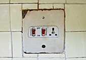Old electrical switches for cooker in kitchen