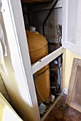 Old-fashioned boiler in airing cupboard