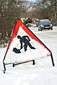Roadworks sign in wintry condition, Suffolk, UK