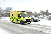 Ambulance answering a call in wintry conditions