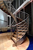 Spiral staircase made of steel and sustainable timber.