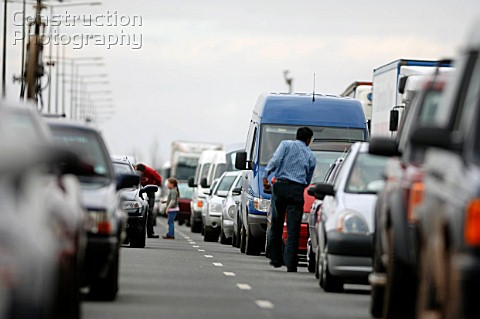 traffic jam on English motorway with people walking around cars