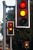 traffic lights showing amber and red at a crossroads, UK.