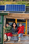 Jyoti Fernandes & family at their self sufficient home fitted with solar panels - Penny Farm, Dorset, UK