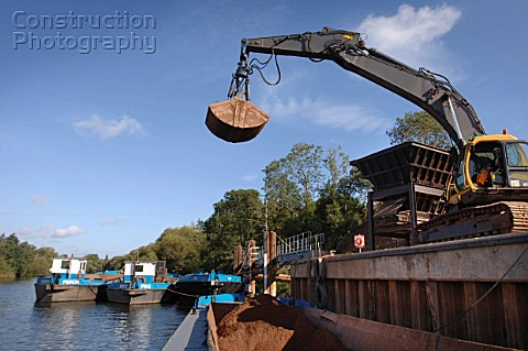 Unloading aggregates from a barge on The River Severn at Ryall Dock Worcestershire UK