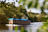 A barge heading to the Ripple Quarry Dock on the River Severn to collect aggregates Gloucestershire UK