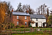 Solar panels on a cottage roof, Herefordshire, UK