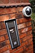 Automated security entry systems on the gatepost of a house, UK