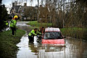 Firemen pulling stranded car out of flood water, Crudwell, Wiltshire, UK, Jan 2009