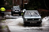 Cars drive through flooded road, Gloucestershire, Uk, 2007