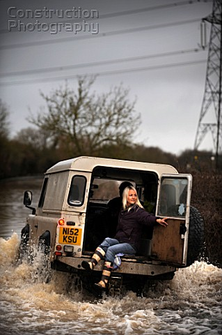 Verity Lester gets a ride through a flood from Mike Bubb to the village of Maisemore from Gloucester