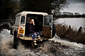 Verity Lester gets a ride through a flood from Mike Bubb to the village of Maisemore from Gloucester (19 Jan 2007).