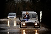Verity Lester gets a ride through a flood from Mike Bubb from the village of Maisemore to Gloucester (19 Jan 2007).