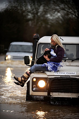 Verity Lester gets a ride through a flood from Mike Bubb from the village of Maisemore to Gloucester