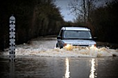 A 4x4 wades through floodwater, Gloucestershire, UK, 2007