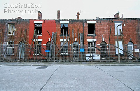 Derelict terraced Victorian houses waiting demolition Salford near Manchester England UK Salfords re