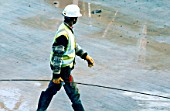 Black construction worker on a building site.