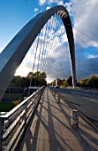 The award-winning Hulme Arch Bridge in Manchester is a showpiece for the civil engineering profession. Though small in scale, this new cable-stayed road bridge in the heart of the Hulme regeneration area is a perfect example of how imaginative design combined with leading-edge engineering technology can be used to create a landmark structure. The 52 m span is supported by a unique single diagonal parabolic arch made from a tapering trapezoidal steel box section coated in Aluminium paint. Engineer: Ove Arup & Partners with Chris Wilkinson Architects.