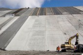 The Karahnjukar dam in Iceland is the highest dam in Europe and the fourth highest in the world. The slope is paved by enormous tiles made by concrete and secured by steel.