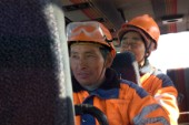 There are over 1.500 contract workers employed in the construction of the Karahnjukar dam in Iceland. The workers are mainly from China which makes the largest group followed by Portugal, Italy, Pakistan. The night shift has just ended and the workers are taken back to the camp.