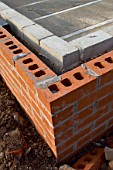 Detail of cavity wall with bricks and breezeblocks.