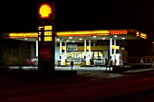 Shell service station at night.
